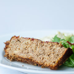 A slice of barbecue turkey meatloaf on a plate