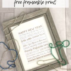 Framed Happy New Year Printable on a wood background.