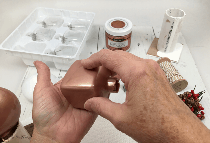Rolling an ornament around to paint the inside