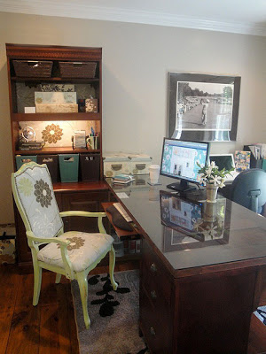 A home office with a green chair
