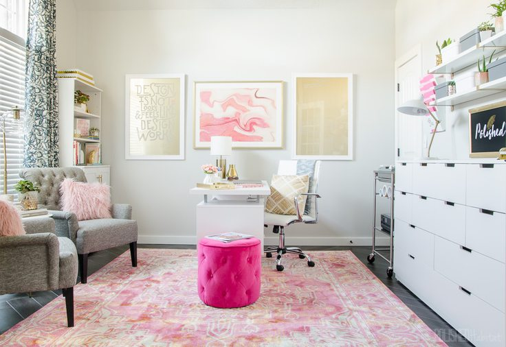 An organized home office with a pink rug