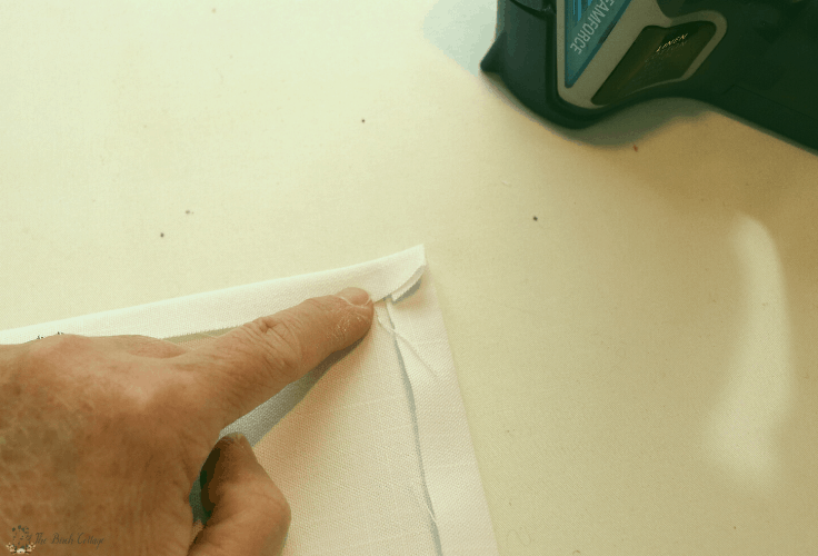 Press the corners together to make mitered corners in your fabric.
