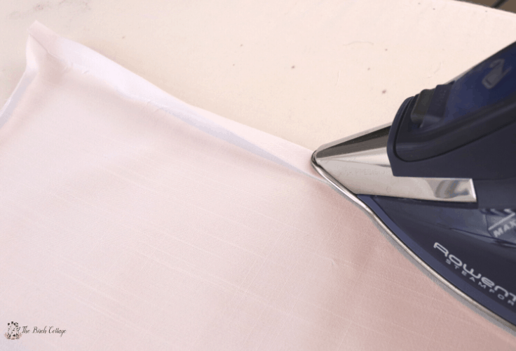 After you fold the fabric, iron it so you can sew it straight.