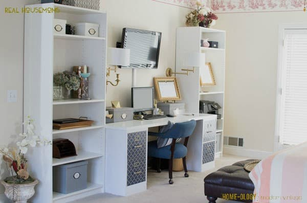 A home office with a white desk and bookshelves