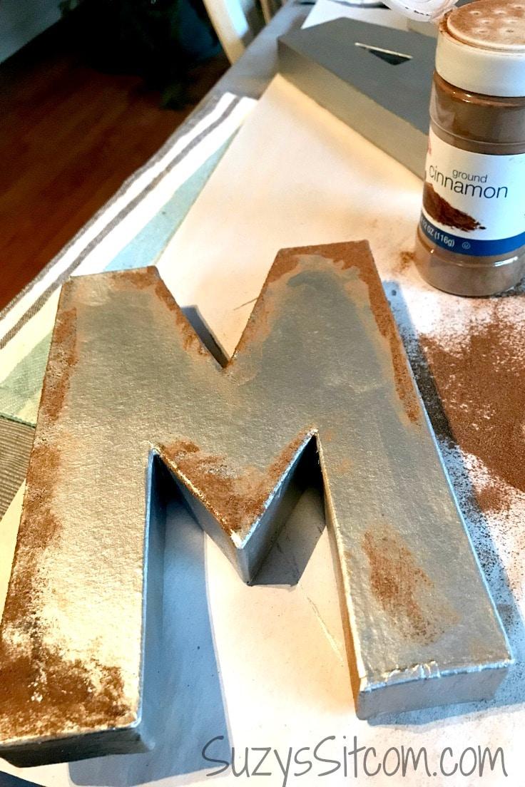 Cinnamon sprinkled on metal-painted letters.