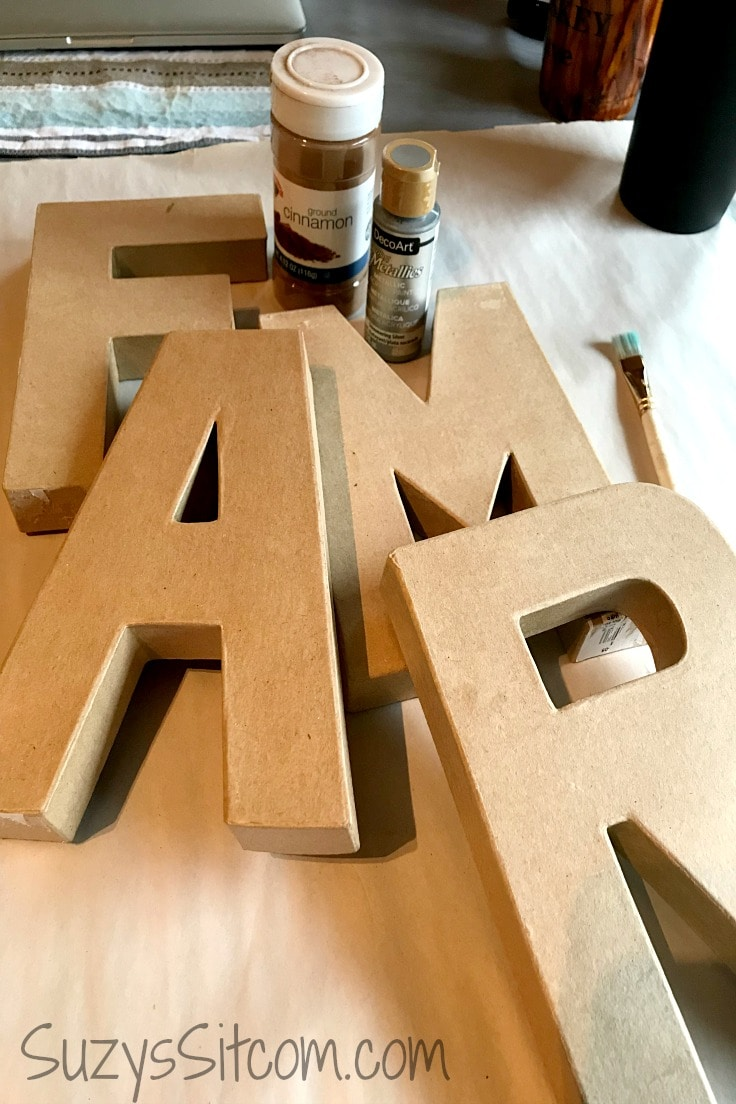 The supplies you need to do faux rust on home decor letters.