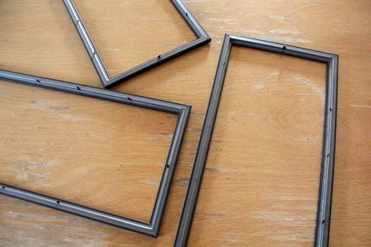 three empty photo frames