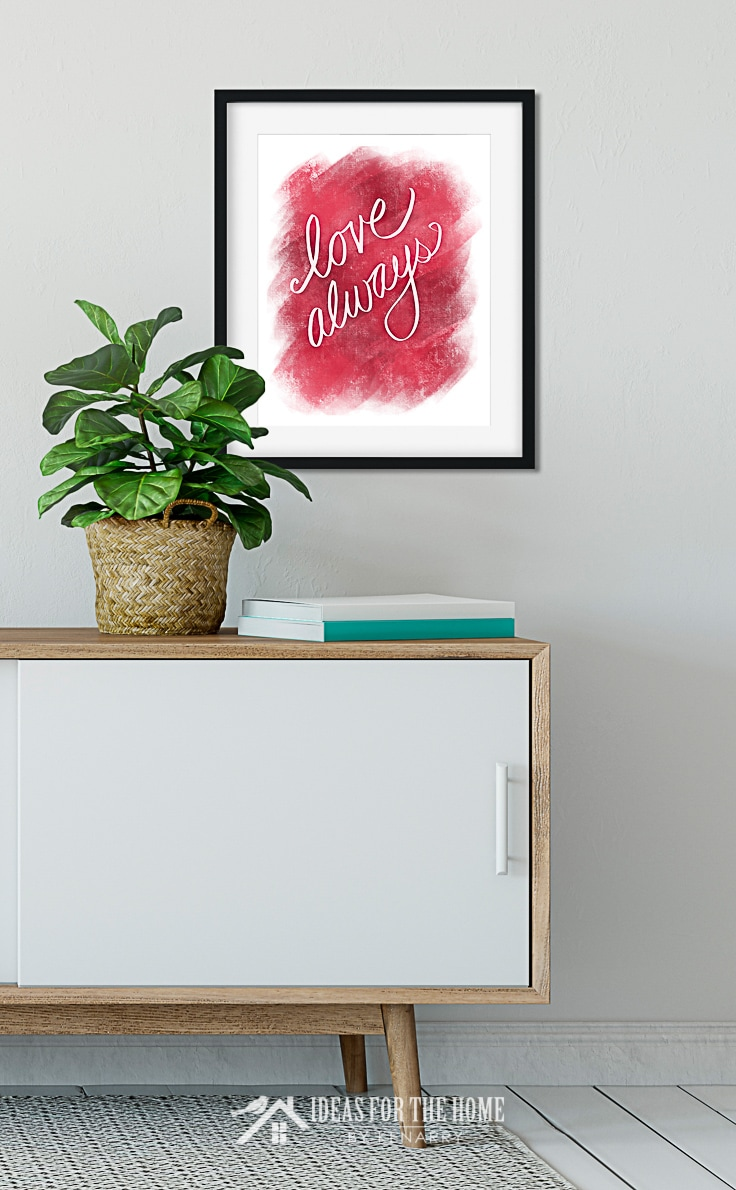 Love Always Valentine's Day printable hanging in a frame on a wall above a modern classic sideboard