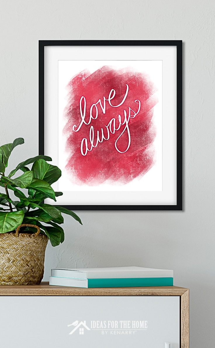 Bright red and pink Valentine's Day wall art hanging above modern style furniture