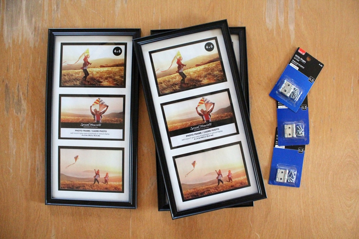 stack of photo frames for 3 4 by 6 photos beside packages of metal hinges