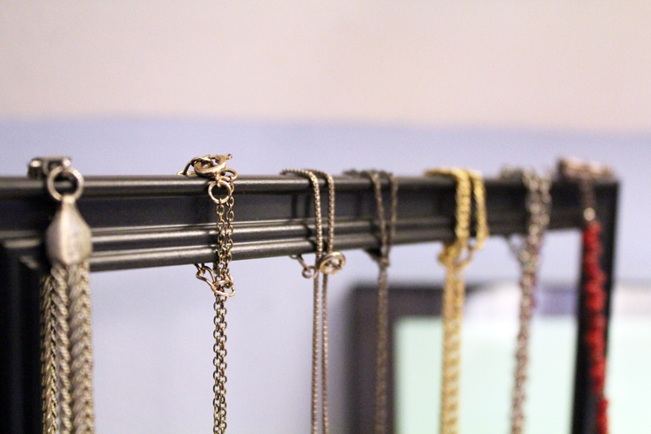 necklace chains loop over the top of the frame
