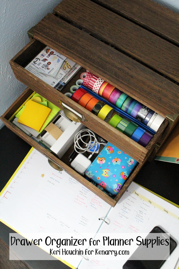2 wooden drawers filled with paper, pens, washi tape, stickers, and other office supplies