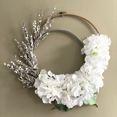 embroidery hoop winter wreath on tan background