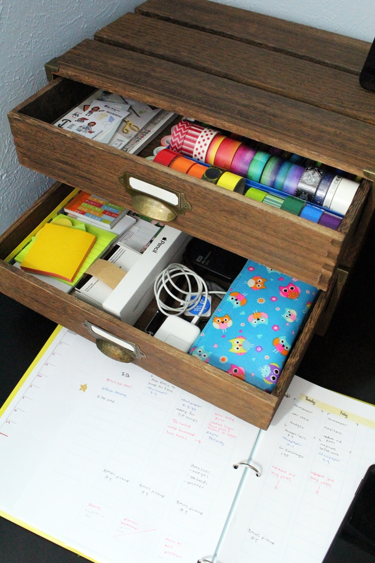 an organized pair of desk drawers filled with office supplies