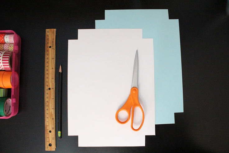 2 cutout box templates, one in white and one in blue