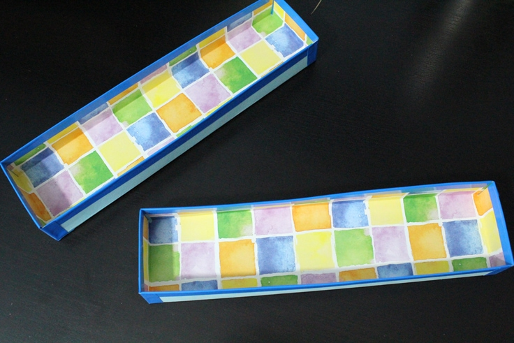 2 small boxes lined with blue washi tape