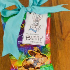 A bag of rabbit shaped graham crackers with a cute gift tag attached for Easter that says