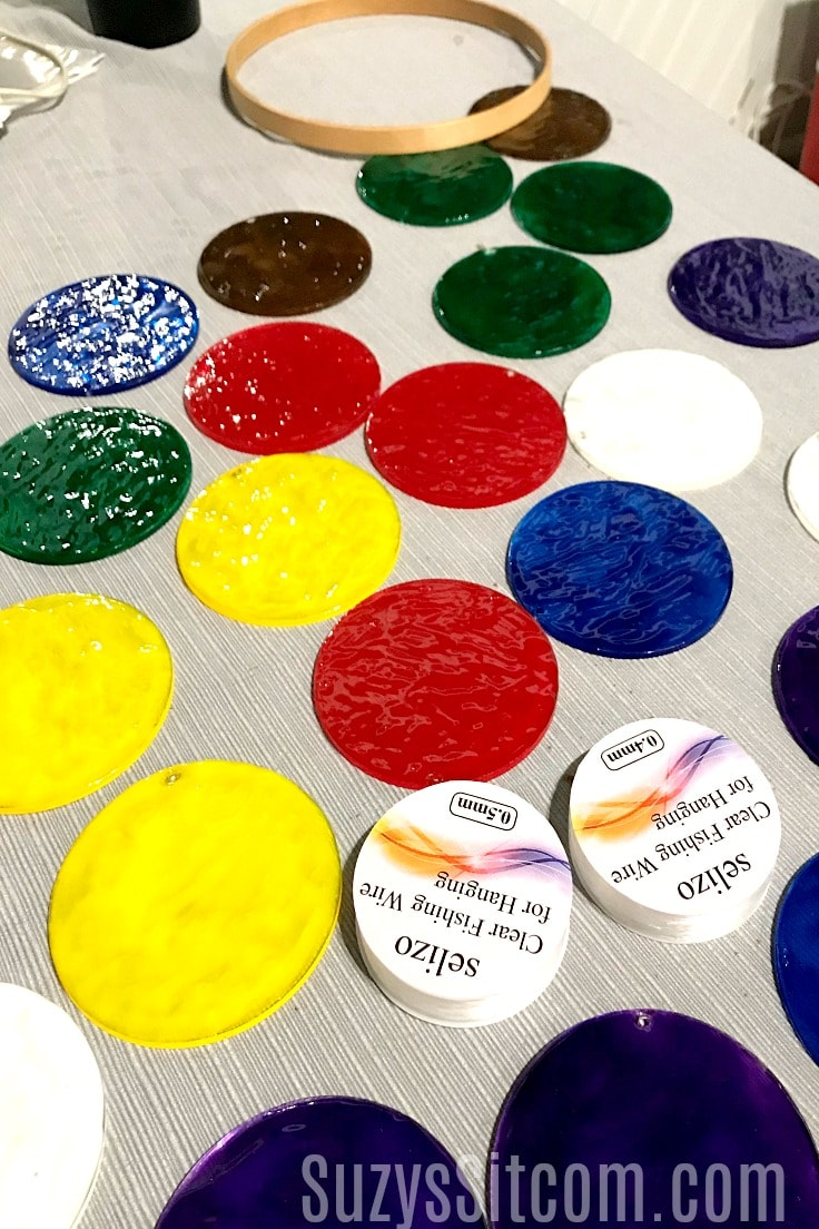 Painted acrylic disks that will be used to make suncatchers