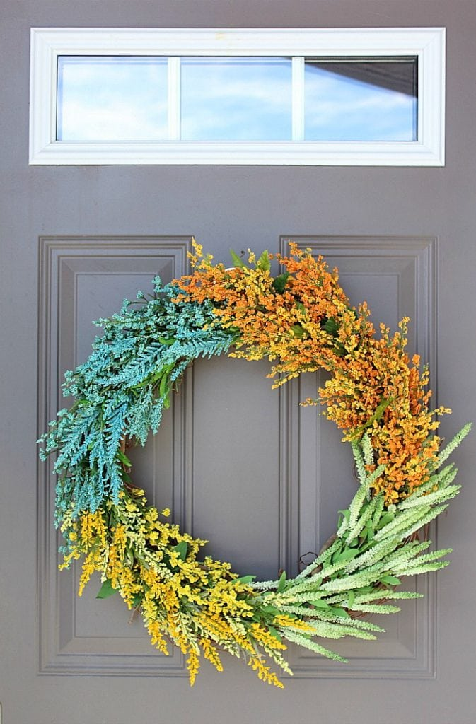 Faux wildflower wreath in various colors.