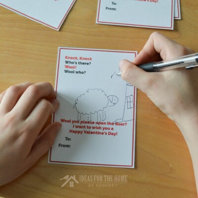 child drawing a sheep on a kids Valentine's Day card