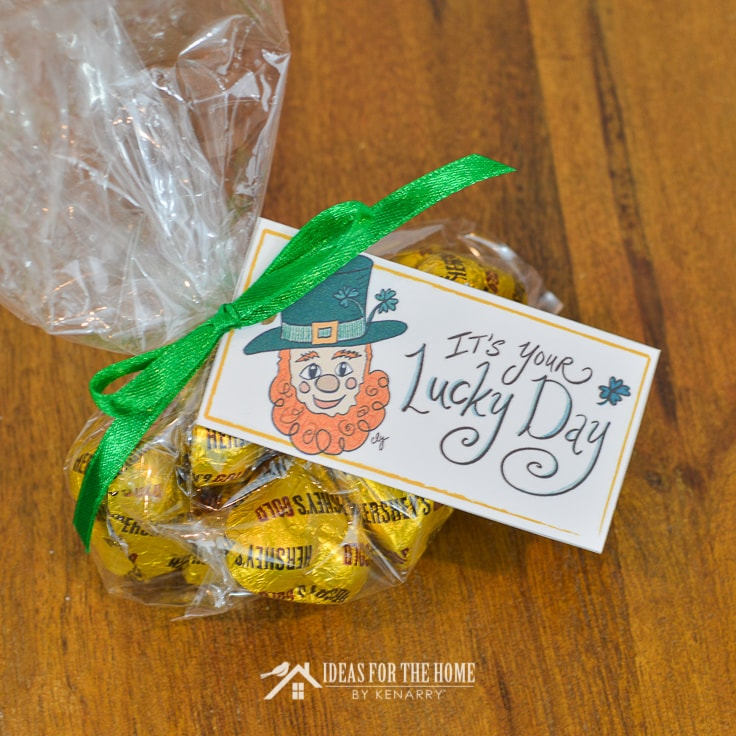 Gold chocolate candy in a treat bag with a St. Patrick's Day gift tag attached
