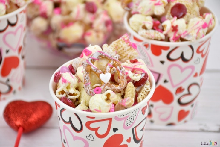Sweet-n-salty Valentine's Day snack mix in cups.