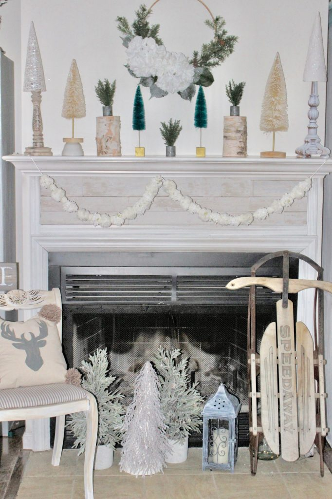 winter mantel with bottle brush trees