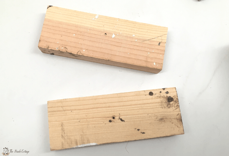 Two pieces of unfinished wood.
