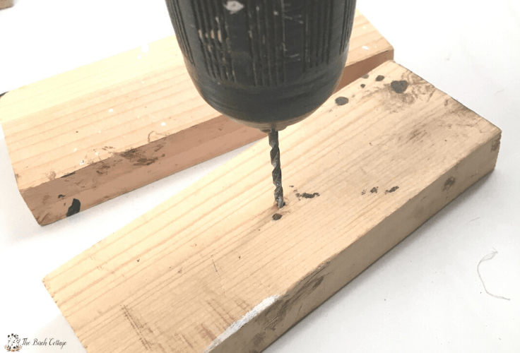 Drilling holes in the unfinished wood blocks.