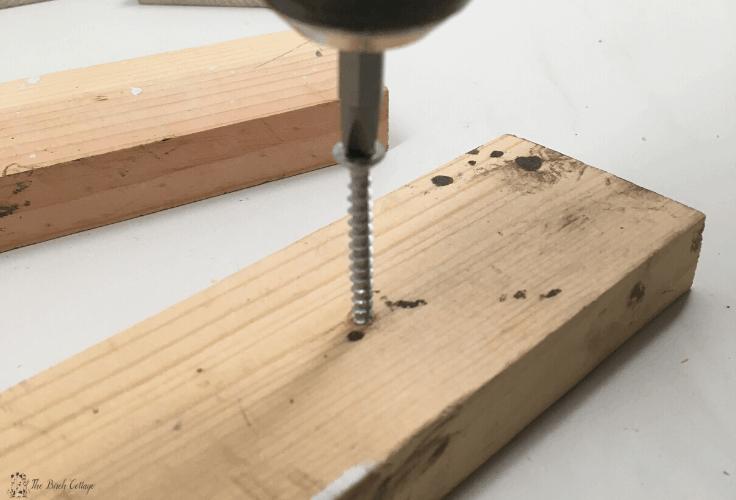 Inserting screws in the wood blocks