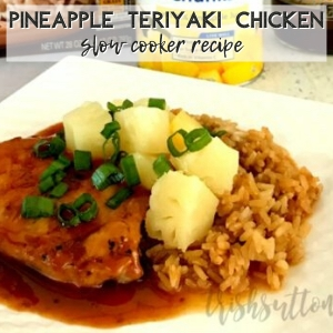 Teriyaki chicken topped with pineapple, onions & sauce plated with rice.