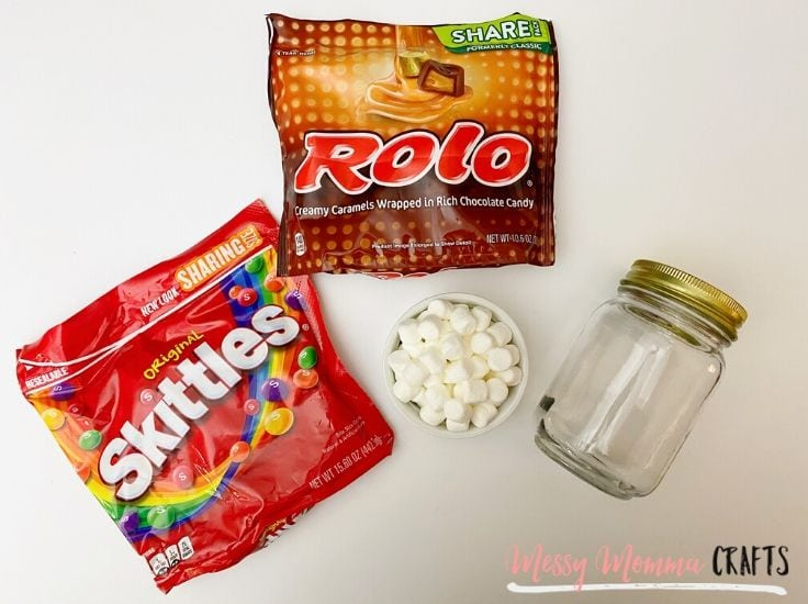 Skittles, Rolo Candies, marshmallows and a clear mason jar