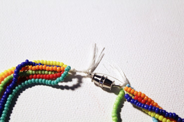 rainbow seed bead necklace connected with a silver metal clasp