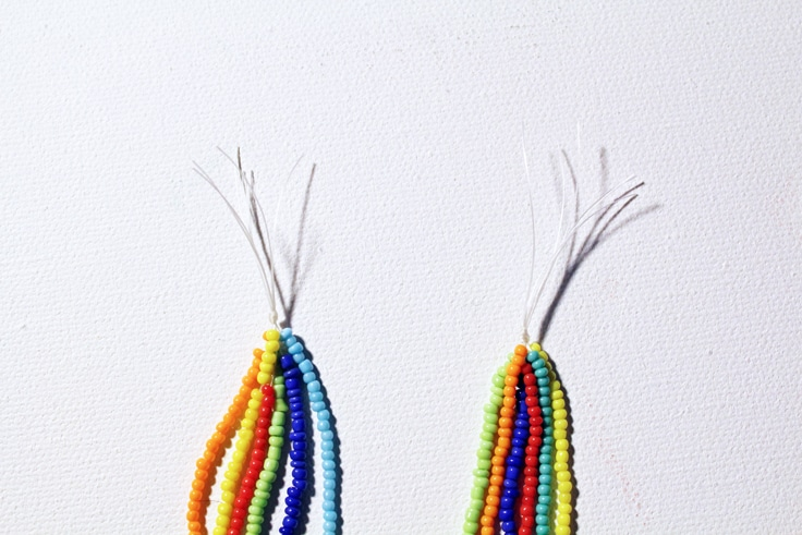 both ends of the rainbow necklace showing the 6 strands tied together