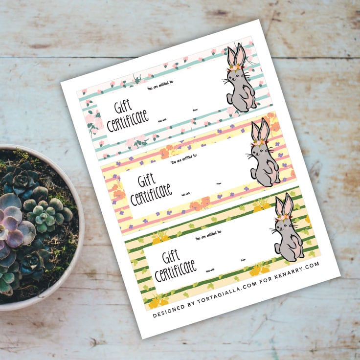 Preview of cute bunny and florals designed printable on wood tabletop with succulent plant.
