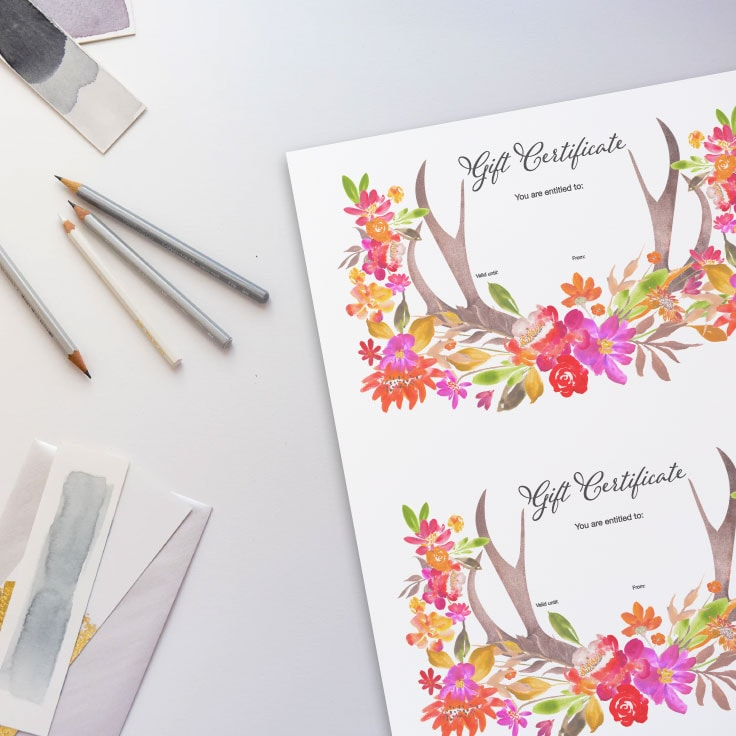Preview of floral designed printable on desk with pencils and watercolor art pieces.