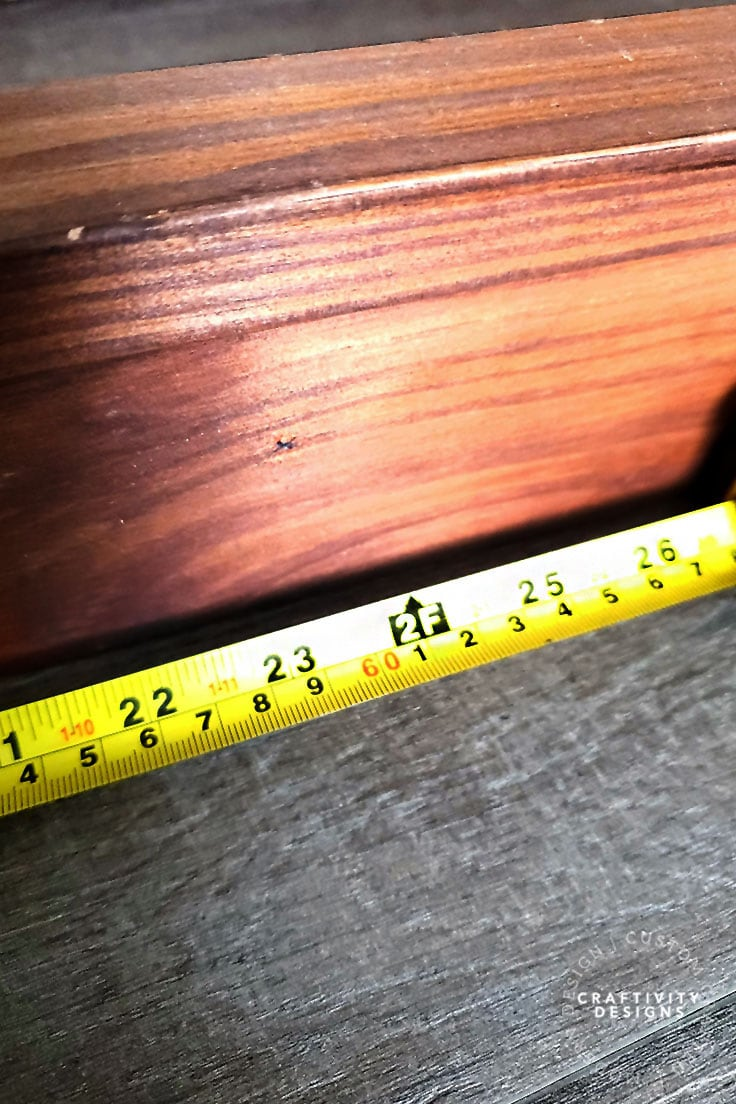 Mark the center point on a wood shelf with a pencil
