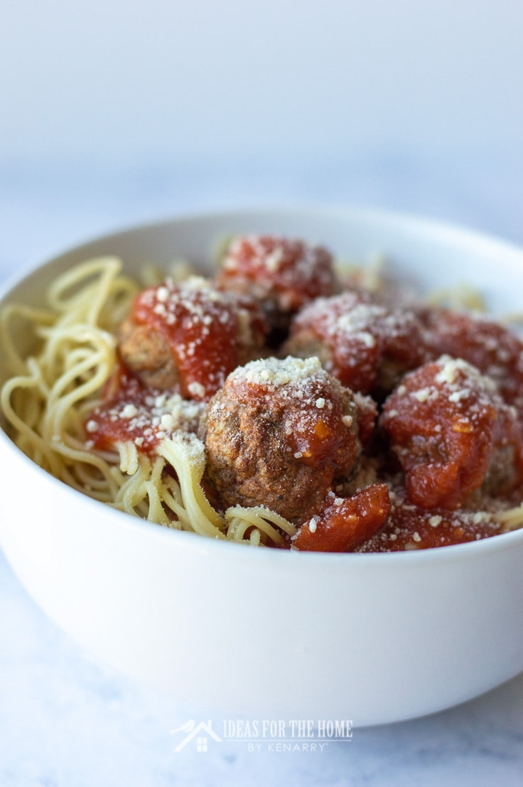Side view of meatballs in a bowl of spaghetti