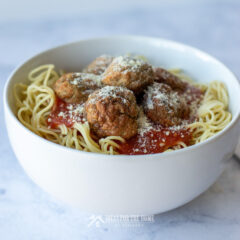 Learn how to make meatballs like these homemade italian meatballs served on a bowl full of spaghetti