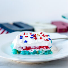 A piece of jello cake with a layer of red, a layer of blue and a layer of white for Team USA