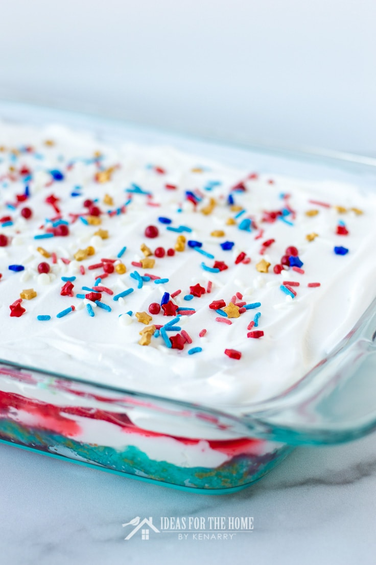 Side view of a red, white and blue layered cake for Independence Day