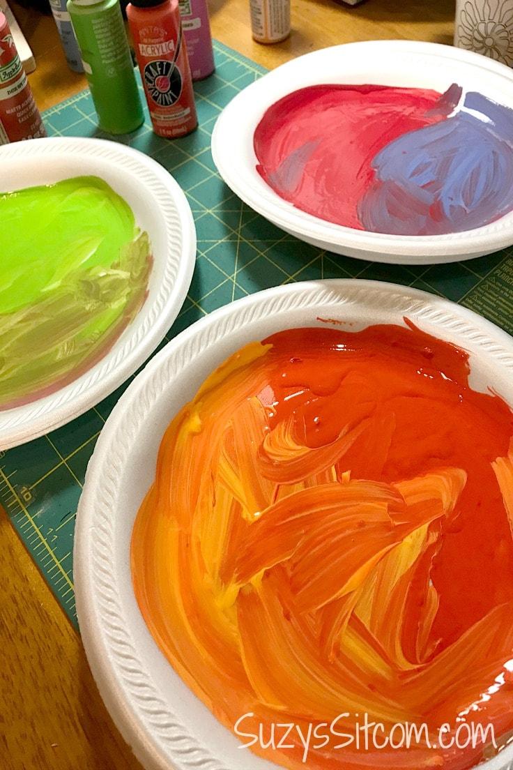 Styrofoam plates with paint on them