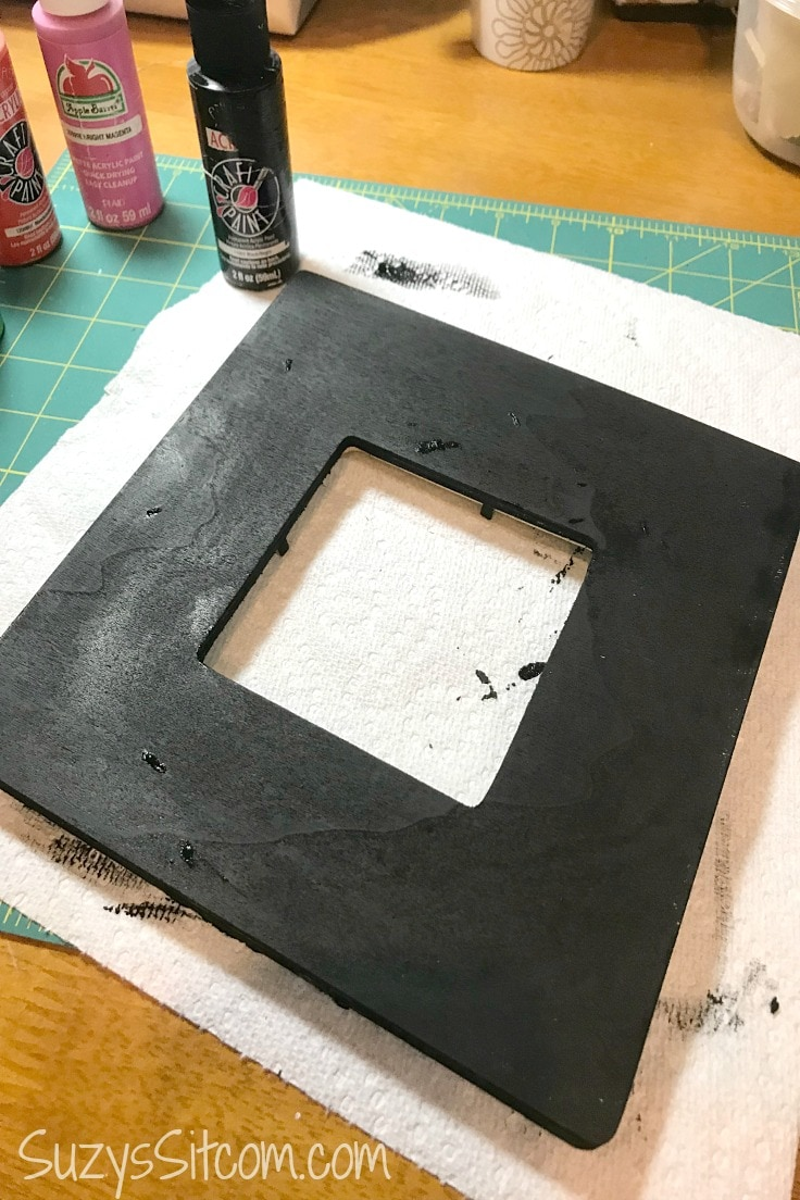 A white frame painted black