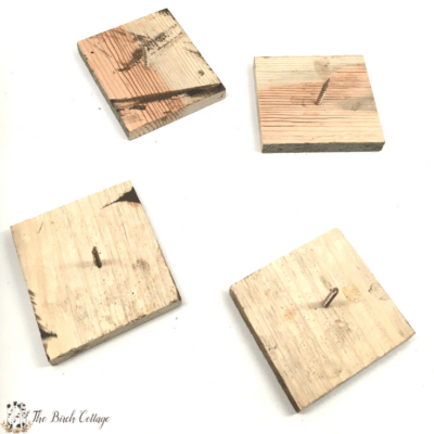 four wood blocks with screws