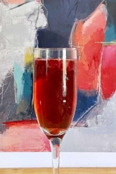 raspberry mimosa in front of colorful picture