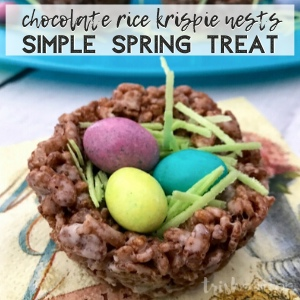 Chocolate Rice Krispies Nest filled with edible grass and three candy eggs.