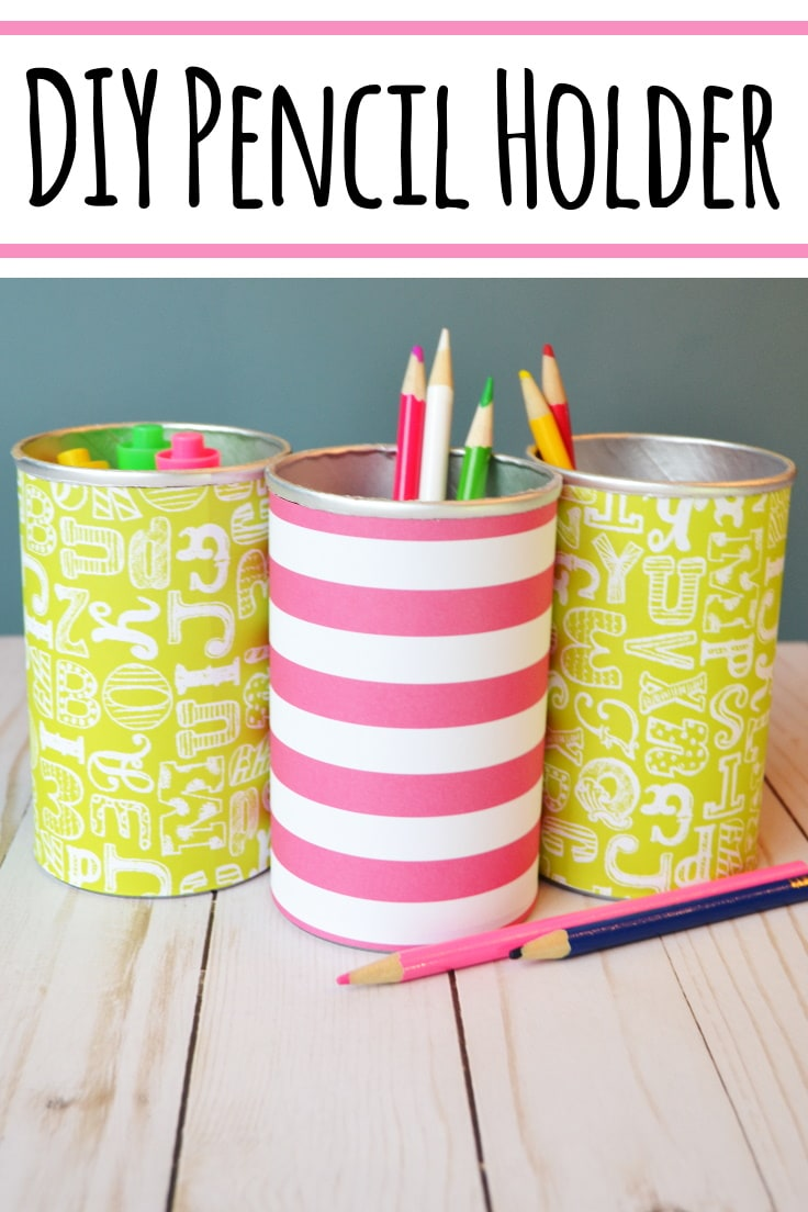 pencil holders with pencils and markers in them
