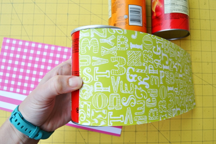 gluing the scrapbook paper onto the chip canister