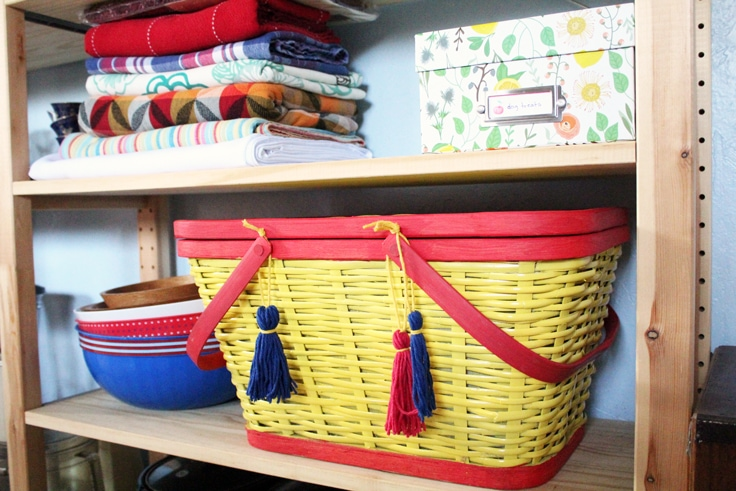 yellow and red painted picnic basket on a kitchen shelf