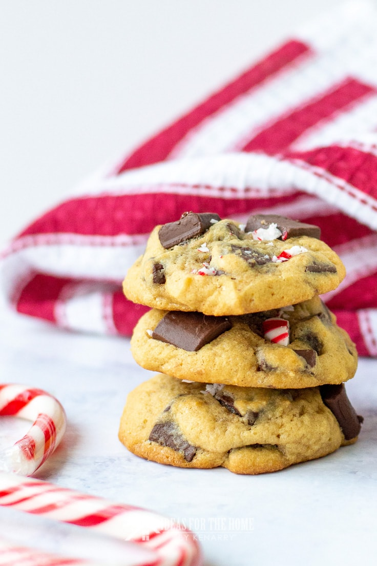A stack of three delicious cookies filled with chocolate chunks and peppermint mocha